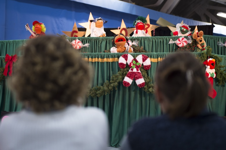 Berryville Baptist Rascals perform a puppet show at the Parents and Children Fighting Cancer holiday party on Joint Base Andrews, Md., Dec. 9, 2017. The event also featured dance performances by Agency 9 Performance Dance Company, face painting and various displays from units assigned to JBA.