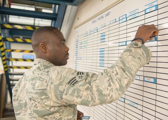 Traditional guardsman Senior Airman Yannick Adjei working as a Vehicle Maintenance and Analysis journeyman at Otis Air National Guard Base, 102nd Intelligence Wing, Joint Base Cape Cod, Mass. on Dec. 2.