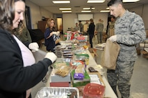 Shower Shaw with Cookies volunteers prepare cookies to be delivered to dorm Airmen during the annual cookie drive at Shaw Air Force Base, S.C., Dec. 7, 2017.