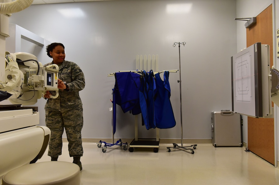Senior Airman Akilah Hall, 19th Medical Support Squadron diagnostic imaging technologist, aims an X-ray tube at a target Dec. 5, 2017, at Little Rock Air Force Base, Ark. The target allows for a standard and reference point for Hall, when she is taking x-rays. (U.S. Air Force photo by Airman 1st Class Rhett Isbell)