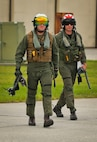Two pilots walk to their F-5N Tiger II aboard Marine Corps Air Station Beaufort, Aug. 21. A detachment of Marine Fighter Training Squadron 401 will be aboard Fightertown from Aug. 20- Sept. 1 providing red air for Marine Fighter Attack Training Squadron 501. VMFT-401 will simulate an enemy for the warlords to fight and maneuver against. The pilot is with VMFT-401.