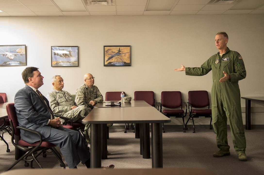 Col. Larry Shaw, 434th Air Refueling Wing commander, explains the base's economic impact to U.S. Rep. Todd Rokita during a mission briefing at Grissom Air Reserve Base, Ind. Nov. 21, 2017. During the briefing Rokita also learned more about the wing mission and its contribution to the Air Force's global reach. (U.S. Air Force graphic/Tech. Sgt. Benjamin Mota)