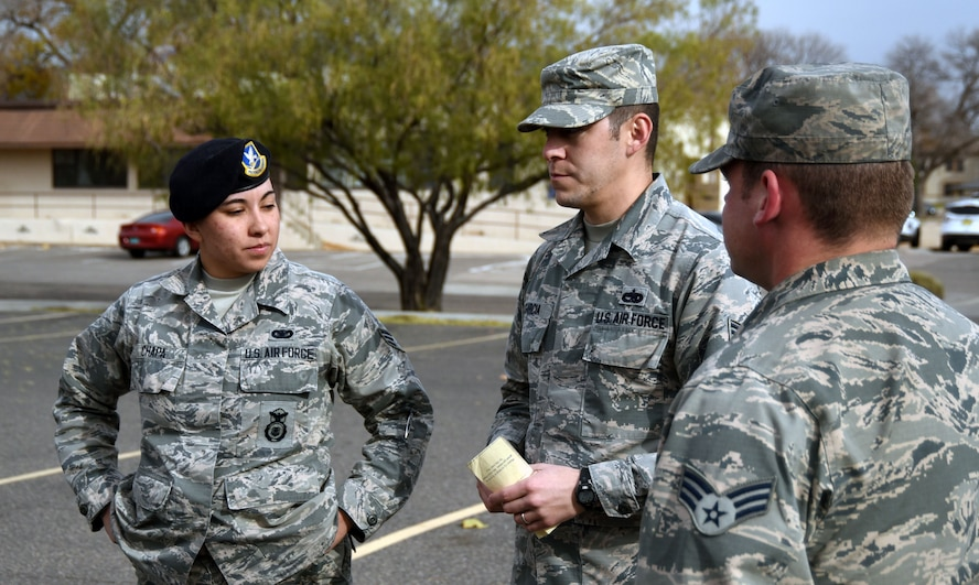 Staff Sgt. Nicholas Garcia, Airman Leadership School flight instructor, provides corrections to students during practice for a drill evaluation at Kirtland Air Force Base, Nov. 30. Garcia, who belongs to the 377th Force Support Squadron, has instructed and mentored over 350 students.
