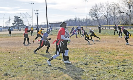The fourth annual Flag Football Turkey Bowl snaps off with speed and talent as Soldiers from Fort Riley and Fort Leavenworth, Kansas, compete for the 22-inch turkey trophy Nov. 22. The bowl is an annual event where teams of Soldiers register and represent their unit.