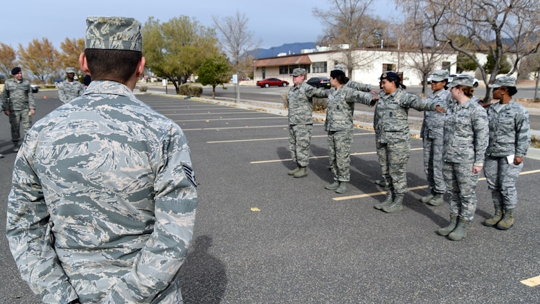 Staff Sgt. Nicholas Garcia, Airman Leadership School flight instructor, observes students practice for the drill evaluation at Kirtland Air Force Base, Nov. 30. Garcia, a member of the 377th Force Support Squadron, has instructed and mentored more than 350 students.