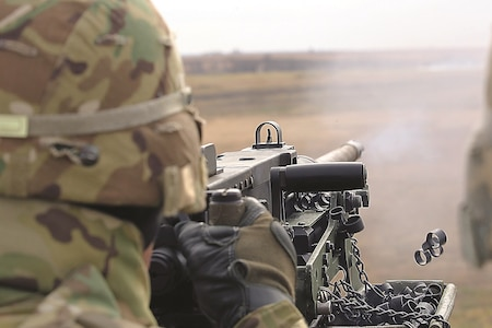 Pvt. Jesus Mendoza, Company E, 3rd Assault Helicopter Battalion, 1st Aviation Regiment, 1st Combat Aviation Brigade, 1st Infantry Division, automated logistics specialist, fires a .50 Cal Browning machine gun on Range 9 at Fort Riley Nov. 7. The Soldiers from 3rd AHB, 1st Avn. Regt. fired several crew served weapon systems to maintain their combat readiness in preparation for any future deployments.
