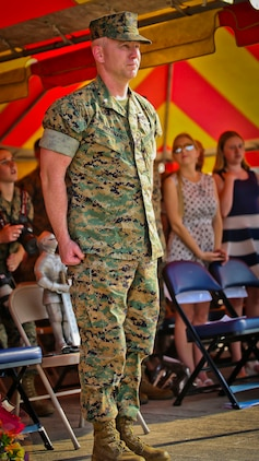 "Lt. Col. Michael P. Brennan Latt stands at attention during the playing of the Marine Corps Hymn during a Relinquishment of Command Ceremony aboard Marine Corps Air Station Beaufort, Sept. 22. During the ceremony, Lt. Col. Michael P. Brennan relinquished command of ""The Flying Leathernecks"" and then cased the squadron colors for transport. The squadron will stand up aboard Marine Corps Air Station Yuma, Ariz. as an F-35B Lightning II Joint Strike Fighter squadron."