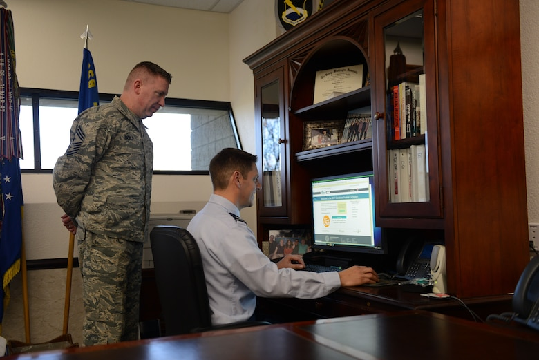 Col. Joe Kunkel, 366th Fighter Wing commander and Chief Master Sgt. Chad Bickley, 366th FW command chief, sign up for the Combined Federal Campaign Nov. 28, 2017, at Mountain Home Air Force Base, Idaho. The CFC raises millions of dollars every year with over 200 campaigns throughout the country.