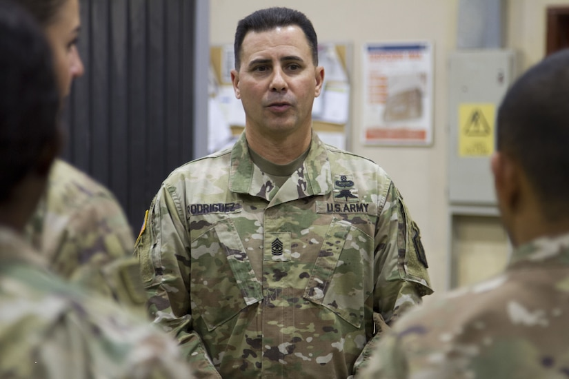 Soldier speaking to a group.