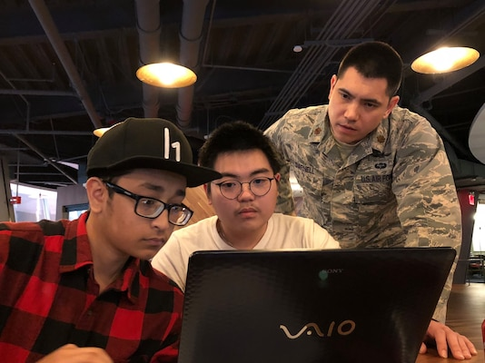 """Maj. Barret Darnell, 315th Cyber Operations Squadron, assists local high school students with some """"Hacking 101"""" challenges"""