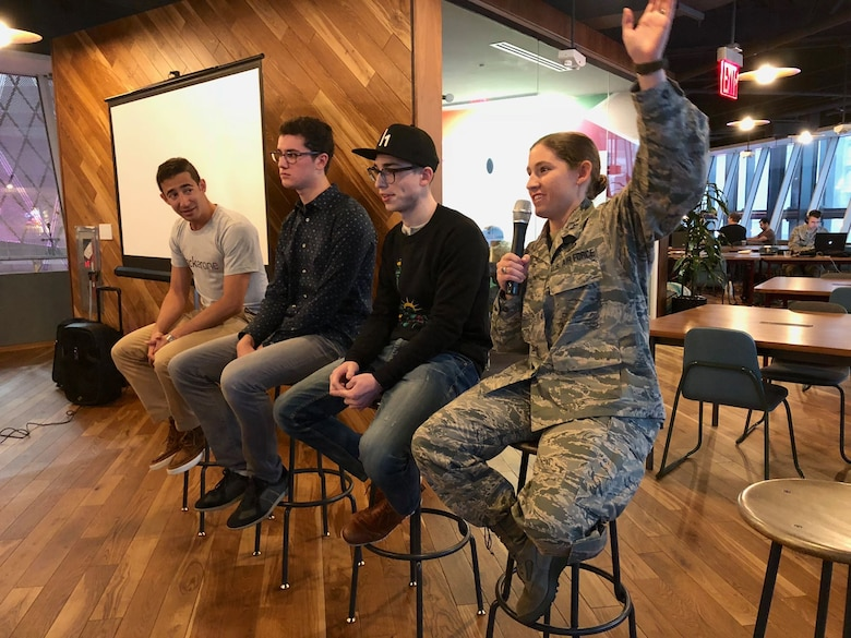 "Capt. Katherine Lawall, 390th Cyber Operations Squadron, answers questions posed by local high school students during a ""Hackers Panel"" Dec. 9, 2017"