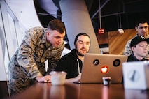 1st Lt. Stephen Baker, 352nd Cyber Operations Squadron, watches as one of the Hack the Air Force 2.0 participants attempts to breach the security on a .mil website Dec. 9, 2017.