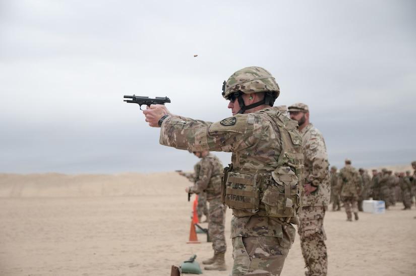 Soldiers firing pistols.
