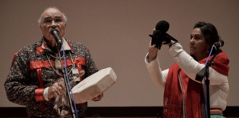 Alicia Pagan and Raymond Two Crows Wallen, founders of the Native American music group Ga-Li, perform a song during the Native American Indian Heritage Month celebration, here, Nov. 28, 2017. The National Air and Space Intelligence Center honored Native Americans throughout the month of November by setting up an artifact display, sending Native American trivia to the workforce and inviting Ga-Li to perform traditional songs.  (U.S. Air Force Senior Airman Samuel Earick/Released)