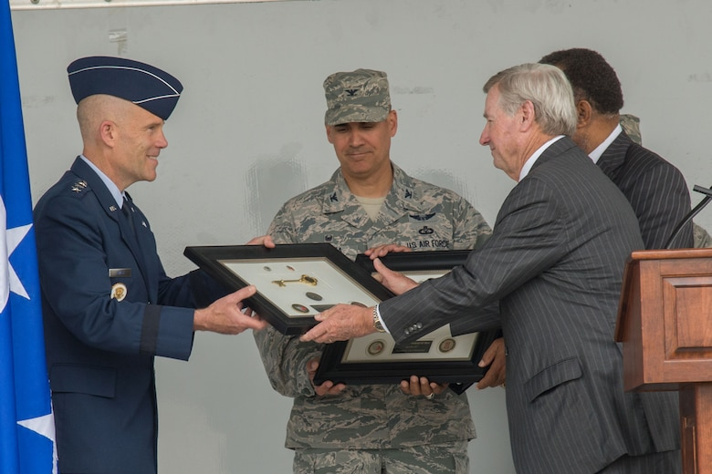 """Montgomery Mayor Todd Strange presents the Keys to the City to Lt. Gen. Steven Kwast, Air University commander, and Col. Eric Shafa, 42nd Air Base Wing commander, April 17, 2017. The mayor presented the keys as a show of appreciation for the Maxwell Air Force Base """"Heritage to Horizon"""" Air Show, April 8-9, 2017. The International Council of Air Shows awarded Maxwell the Dick Schram Memorial Community Relations Award for having the best air show in 2017. (U.S. Air Force photo by Trey Ward)"""