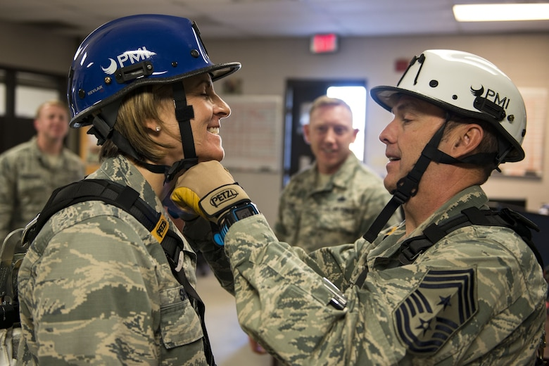 Chief Master Sgt. Jarrod Sebastian, right, 23d Wing command chief, adjusts Col. Jennifer Short's, 23d Wing commander, helmet before they climb a radio antenna tower as part of an immersion tour, Dec. 11, 2017, at Moody Air Force Base, Ga. Moody leadership visited the radar, airfield and weather systems facility to familiarize themselves with the 23d Operations Support Squadron's duties and to gain a better understanding of how they impact the mission. (U.S. Air Force photo by Airman 1st Class Erick Requadt)