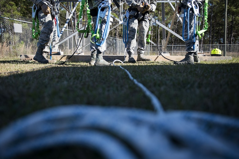 Team Moody Airmen get ready to climb a radio antenna tower during an immersion tour, Dec. 11, 2017, at Moody Air Force Base, Ga. Moody leadership visited the radar, airfield and weather systems facility to familiarize themselves with the 23d Operations Support Squadron's duties and to gain a better understanding of how they impact the mission. (U.S. Air Force photo by Airman 1st Class Erick Requadt)