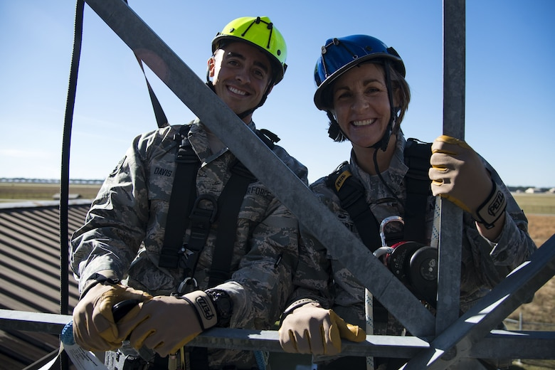 Senior Airman Grant Davis, left, 23d Operations Support Squadron (OSS) radar, airfield and weather systems (RAWS) technician, and Col. Jennifer Short, 23d Wing commander, pose for a photo during an immersion tour, Dec. 11, 2017, at Moody Air Force Base, Ga. Moody leadership visited the RAWS facility to familiarize themselves with the 23d OSS's duties and to gain a better understanding of how they impact the mission. (U.S. Air Force photo by Airman 1st Class Erick Requadt)