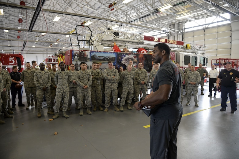 Professional athlete, Herschel Walker, speaks with Airmen of the 436th Civil Engineer Squadron Dec. 5, 2017, at the fire department on Dover Air Force Base, Del. Walker answered questions about his football career and struggles with mental health. (U.S. Air Force photo by Staff Sgt. Aaron J. Jenne)