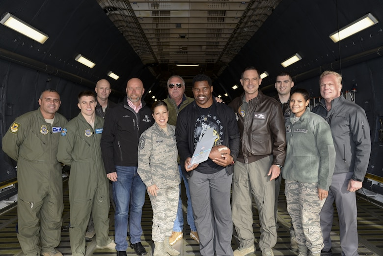 Professional athlete, Herschel Walker, receives a tail-flash aboard a C-5M Super Galaxy Dec. 6, 2017, at Dover Air Force Base, Del. Walker's tour raised awareness for mental health, stressing the importance of seeking help early on. (U.S. Air Force photo by Staff Sgt. Aaron J. Jenne)