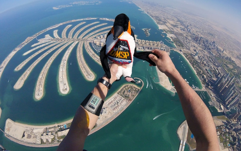 Maj. Matthew Shull, 6th Space Operations Squadron, takes the DMSP (Defense Meteorological Satellite Program) mascot for a flight during the 9th World Cup of Canopy Piloting event in Dubai, United Arab Emirates, Dec. 1, 2017.