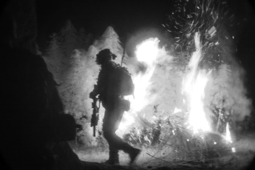 A U.S. Special Forces soldier, attached to Special Operations Task Force-Afghanistan, sets fire to a field of marijuana, found outside of a compound housing a drug lab, during an operation in the Ghorak district, Helmand province, Afghanistan.