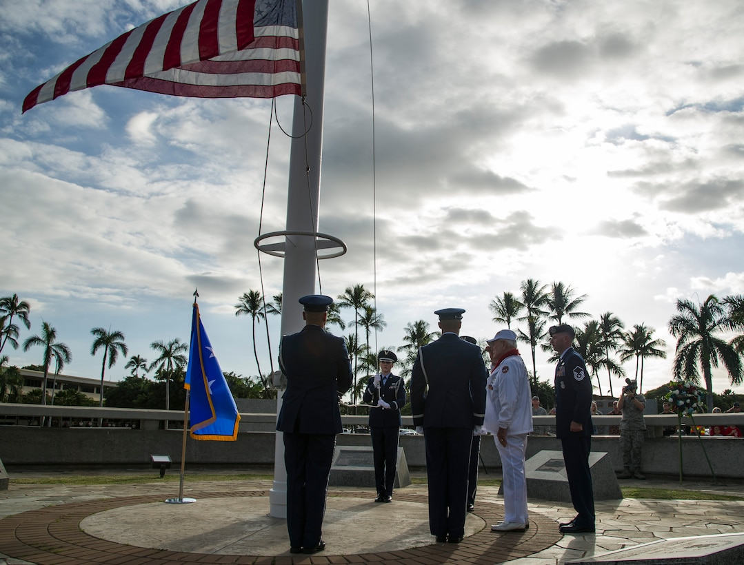 Former Tech. Sgt. Durward Swanson helps the Hickam Honor Guard take down the U.S. flag.