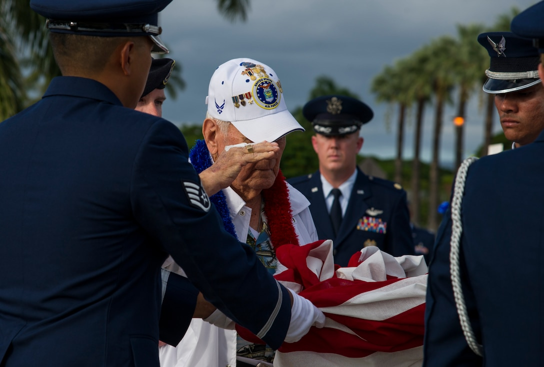 Former Tech. Sgt. Durward Swanson salutes the U.S. flag during a retreat ceremony.