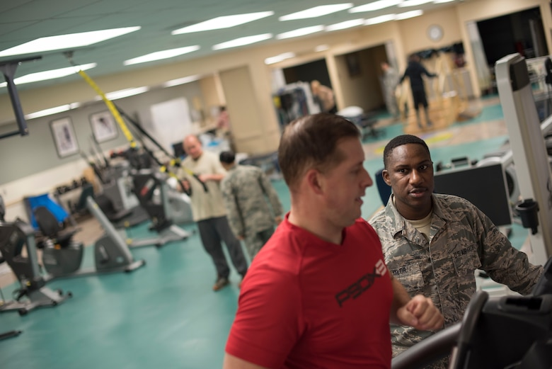 Staff Sgt. Christian J. Taylor, 60th Medical Operations physical medicine technician, directs his patient Tech. Sgt. James Hodgman, 60th Air Mobility Wing Public Affairs NCO in charge of command information, at the physical therapy clinic inside David Grant USAF Medical Center at Travis Air Force Base, Calif., Nov. 27, 2017. The physical therapy clinic is comprised of dedicated professionals who specialize in providing care for musculoskeletal disorders and movement dysfunction. (U.S. Air Force photo by Airman 1st Class Jonathon D. A. Carnell)
