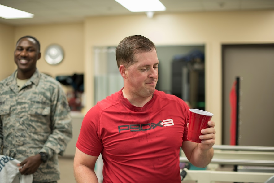 Tech. Sgt. James Hodgman, 60th Air Mobility Wing Public Affairs NCO in charge of command information, hydrates during a training session at the physical therapy clinic inside David Grant USAF Medical Center at Travis Air Force Base, Calif., Nov. 27, 2017. The physical therapy clinic is comprised of dedicated professionals who specialize in providing care for musculoskeletal disorders and movement dysfunction. (U.S. Air Force photo by Airman 1st Class Jonathon D. A. Carnell)