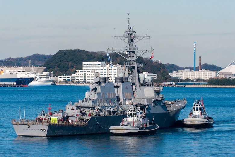 TOKYO BAY, Japan (Dec. 13, 2017) - The Arleigh Burke-class guided-missile destroyer USS John S. McCain (DDG 56) is towed to the pier at Fleet Activities (FLEACT) Yokosuka. John S. McCain will undergo repairs at Ship Repair Facility – Japan Regional Maintenance Center in Yokosuka.
