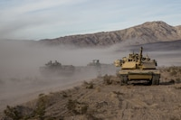U.S Marines with 3rd Battalion, 4th Marine Regiment, 1st Marine Division, utilize an M1A1 Abrams tank during exercise Steel Knight 18 at Marine Corps Air Ground Combat Center Twentynine Palms, Calif., Dec. 10, 2017. SK-18 is a division level exercise designed to enhance the command and control and interoperability with the 1st MARDIV, its adjacent units and naval support forces.