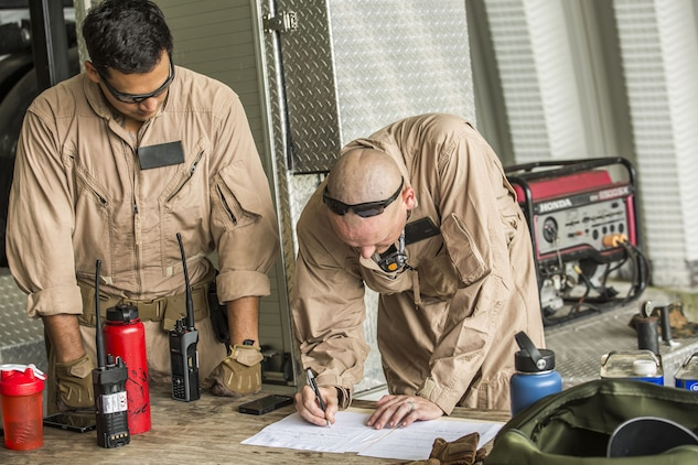 Sergeant Stephen Gomez, left and Gunnery Sergeant Vance Bercot, right review steps in the inerting process of an M72-A7 Law while conducting inerting training aboard Marine Corps Air Station Beaufort , July 25. Explosive Ordnance Disposal Marines held the inerting process as part of their quarterly training. Gomez and Bercot are both EOD technicians with EOD, MCAS Beaufort.