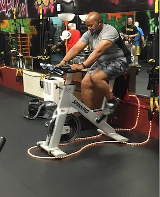 A soldier works out on a stationary bike