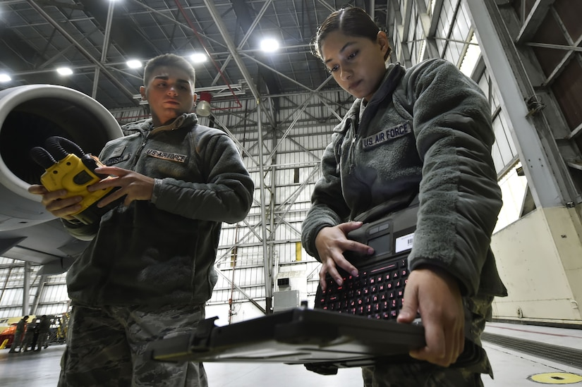 Airman 1st Class Richard Johnson, left, and Airman 1st Class Yasuary Martinez, both 437th Aircraft Maintenance Squadron aerospace maintenance journeymen, perform ground maintenance on a C-17 Globemaster III in preparation for a Joint Forcible Entry training event in support of the U.S. Air Force Weapons School Integration phase Dec. 8. Thirty seven C-17s, 21 C-130 Hercules and 120 U.S. Army paratroopers participated in the mobility portion of the WSINT phase during a simulated mass JFE event over a contested target Dec. 9, on a range near Nellis Air Force Base, Nev. The event demonstrates the U.S. Air Force's ability to execute rapid, decisive responses to crises worldwide.