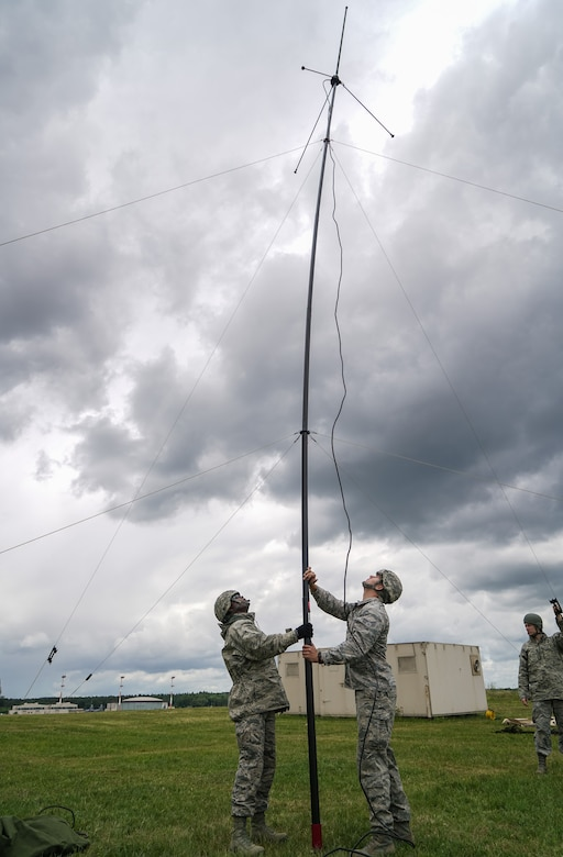 U.S. Air Force Master Sgt. Columbus Cook, an operations technician with the 116th Air Control Wing (ACW), 116th Civil Engineer Squadron (CES), Georgia Air National Guard (GANG), and Senior Airman John Rosales, with the 786th CES, Ramstein Air Base, Germany, raise a tactical communications antenna during United States Air Forces Europe (USAFE) Silver Flag 2017 at Ramstein Air Base, Germany, June 7, 2017. A team 41 GANG civil engineers from the 116th ACW are participating in USAFE Silver Flag 2017.