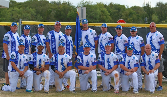 Senior Airman Michael Higgins, High Frequency Global Communication System radio operator with the 319th Communications Squadron, second from the back right, poses with the men's All-Air Force softball team at Fort Sam Houston, Texas. (Courtesy photo)