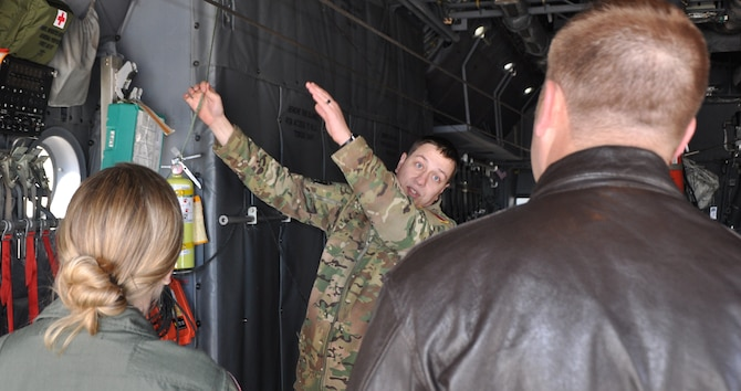 Staff Sgt. David Metroka, a C-130H loadmaster with the 700th Airlift Squadron, Dobbins, Air Reserve Base, Georgia, shows loadmasters from the 731st Airlift Squadron the towed parachute retrieval system during the loadmaster refresher course, Nov. 18 at Peterson Air Force Base, Colorado. (U.S. Air Force photo/Daniel Butterfield)
