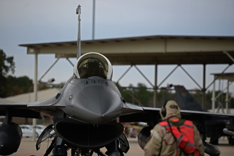 U.S. Air Force Tech. Sgt. Joseph Collett, 20th Aircraft Maintenance Squadron, 79th Aircraft Maintenance Unit flightline expeditor, taxis an F-16CM Fighting Falcon at Shaw Air Force Base, S.C., Dec. 7, 2017.