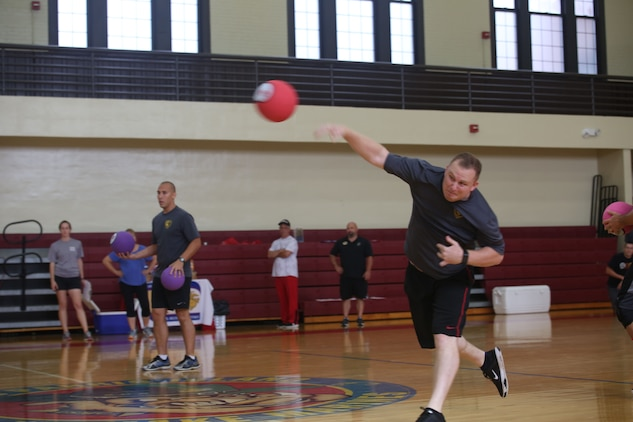 A Marine and his teammates take part in a dodgeball tournament as part of the SEMPERFIT Summer Challenge aboard Marine Corps Recruit Depot Parris Island, August 8. The summer challenge is a program that promotes a healthy, active lifestyle and builds unit cohesion.