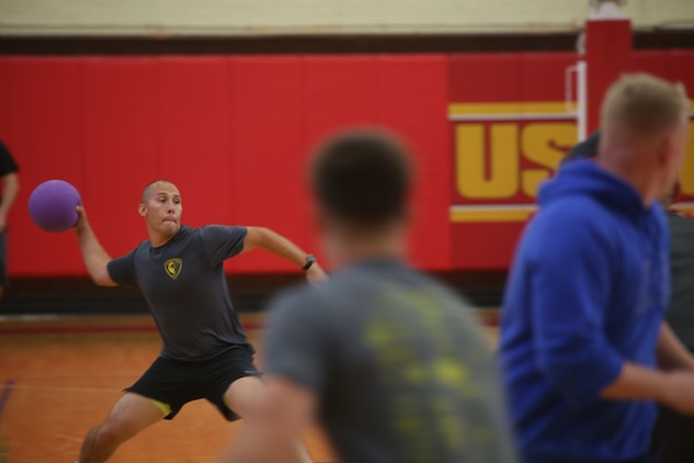 A Marine throws a dodgeball as part of a tournament for the SEMPERFIT Summer Challenge aboard Marine Corps Recruit Depot Parris Island, August 8. The summer challenge is a program that promotes a healthy, active lifestyle and builds unit cohesion.