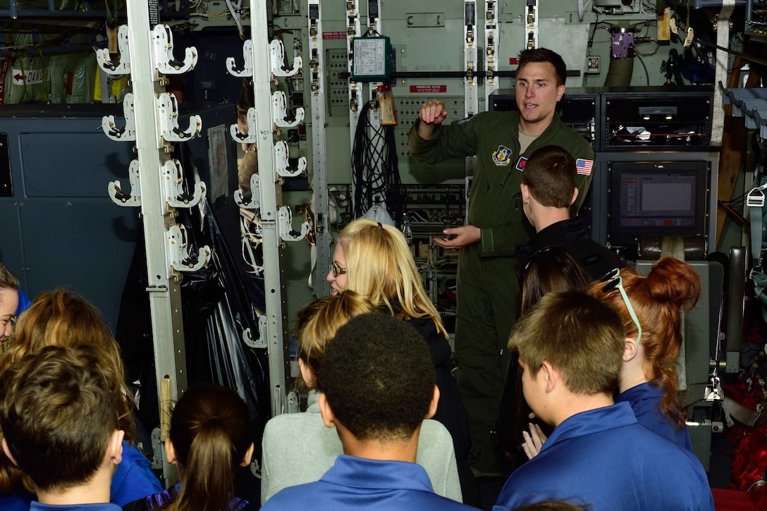 "Staff Sgt. Nathan Calloway, 53rd Weather Reconnaissance Squadron weather reconnaissance loadmaster, talks about the 53rd WRS ""Hurricane Hunters"" mission to students and teachers from Courtney Christian School out of Hammond, Alabama, Dec. 12, 2017, at Keesler Air Force Base, Mississippi. The school group toured one of the squadron's WC-130J Super Hercules aircraft and visited the 41st Aerial Port Squadron to learn about how they support the flying missions of the 53rd WRS and the 815th Airlift Squadron. (U.S. Air Force photo by Tech. Sgt. Ryan Labadens)"