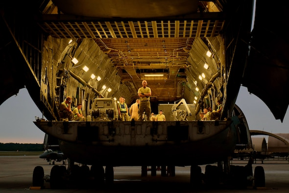 Staff Sgt. Richard Averitt, 4th Logistics Readiness Squadron air transportation specialist, waits for cargo to be loaded on a C-5M Super Galaxy, Sept. 29, 2017, at Seymour Johnson AFB, North Carolina. The 4th LRS provides worldwide logistics support for the 4th Fighter Wing. (U.S. Air Force photo by Airman 1st Class Victoria Boyton)
