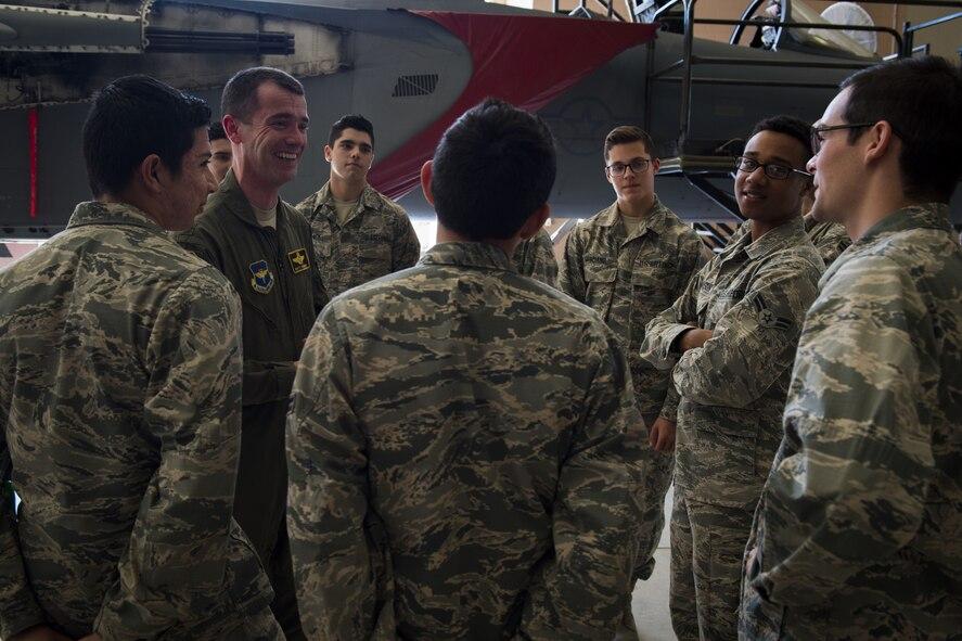 A pilot mentors Airmen.