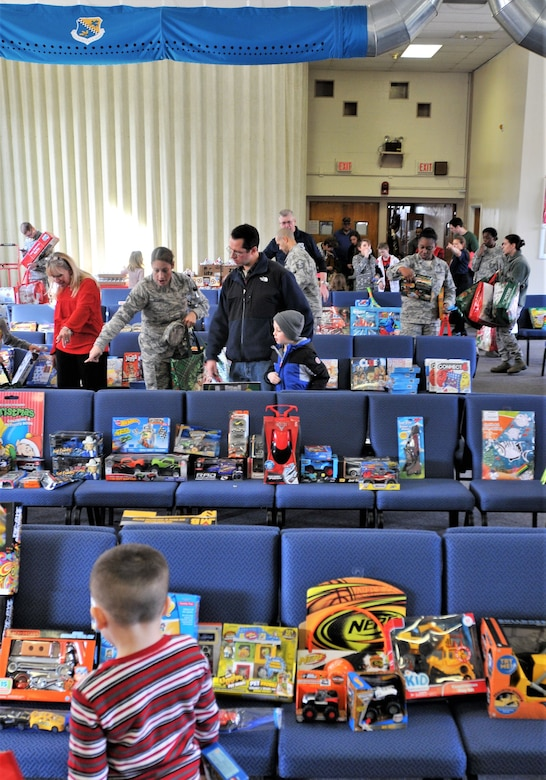 Premium toys donated by Operation Homefront line the chairs during a Holiday event for military families held Dec. 2, 2017, at Horsham Air Guard Station, Pa. The toys were donated to more than 350 children of military families through regional civilian-military partnership programs. (U.S. Air National Guard photo by Tech. Sgt. Andria Allmond)