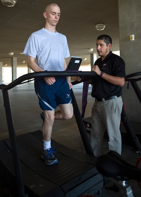 Arnoldo Gonzalez, an athletic trainer embedded with the 559th Medical Group's VIPER Clinic, assesses trainee Alec Sollars on a trueform treadmill at the 559th MDG VIPER Clinic on Joint Base San Antonio-Lackland, Texas, Nov. 29. This treadmill is completely motorless and is uniquely designed so that it does not allow anyone to run on it with improper running form. This instant feedback tool that teaches trainees how to properly run and hopefully prevent any further injuries.