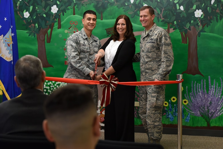 U.S. Air Force Col. Ricky Mills, 17th Training Wing commander, Megan Fowler, 17th TRW specialist for the primary prevention of violence, and Col. Jeffrey Sorrell, 17th TRW vice commander, cut the ribbon for the new resiliency center on Goodfellow Air Force Base, Texas, Dec. 11, 2017. Fowler was the primary coordinator for the acquisition and renovation of building 104 for the new center.  (U.S. Air Force photo by Airman 1st Class Seraiah Hines/Released)