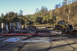 Crews work to remove debris from Santa Rosa Fire Department's old Station 5 location on Parker Hill Road.