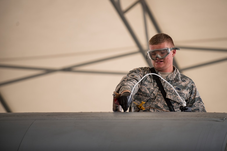 Airman 1st Class Gabriel Vorce, 23d Aircraft Maintenance Squadron crew chief, checks the oil on an A-10C Thunderbolt II during a thru flight inspection, Dec. 7, 2017, at Moody Air Force Base, Ga. Moody recently participated in a week-long, Phase 1, Phase 2 exercise designed to demonstrate the 23d Wing's ability to meet combatant commander objectives. The exercise tested pilots' and maintainers' ability to launch around-the-clock sorties at an accelerated rate during surge operations. (U.S. Air Force photo by Andrea Jenkins)