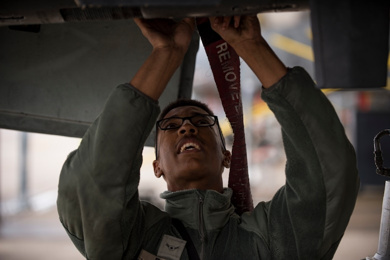 A crew chief from the 23d Aircraft Maintenance Squadron secures a panel on an A-10C Thunderbolt II during a thru flight inspection, Dec. 7, 2017, at Moody Air Force Base, Ga. Moody recently participated in a week-long, Phase 1, Phase 2 exercise designed to demonstrate the 23d Wing's ability to meet combatant commander objectives. The exercise tested pilots' and maintainers' ability to launch around-the-clock sorties at an accelerated rate during surge operations. (U.S. Air Force photo by Andrea Jenkins)